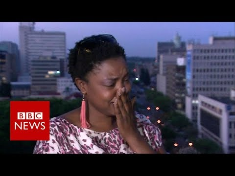 Thumbnail: Mugabe resigns: activist breaks down in tears of Joy - BBC News