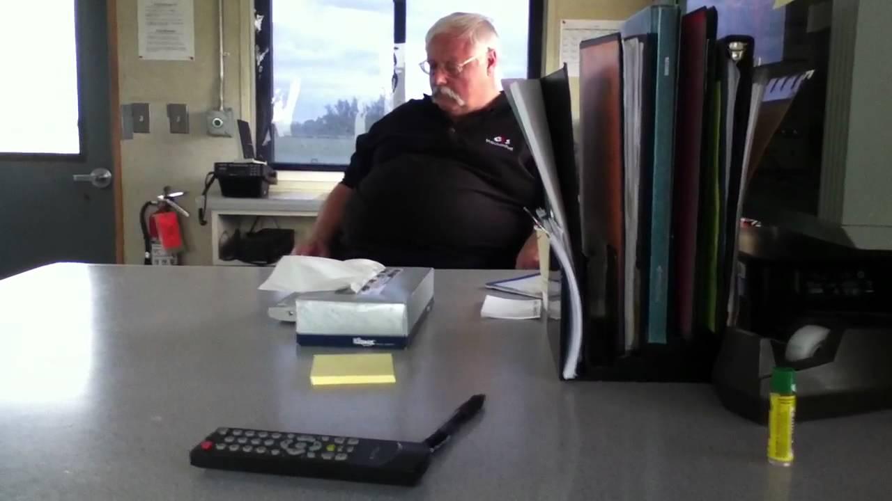 old man falling asleep at work