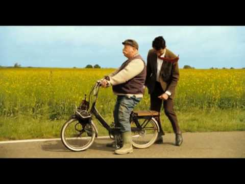 Mr Bean's holidayMr Bean and man with motorbike