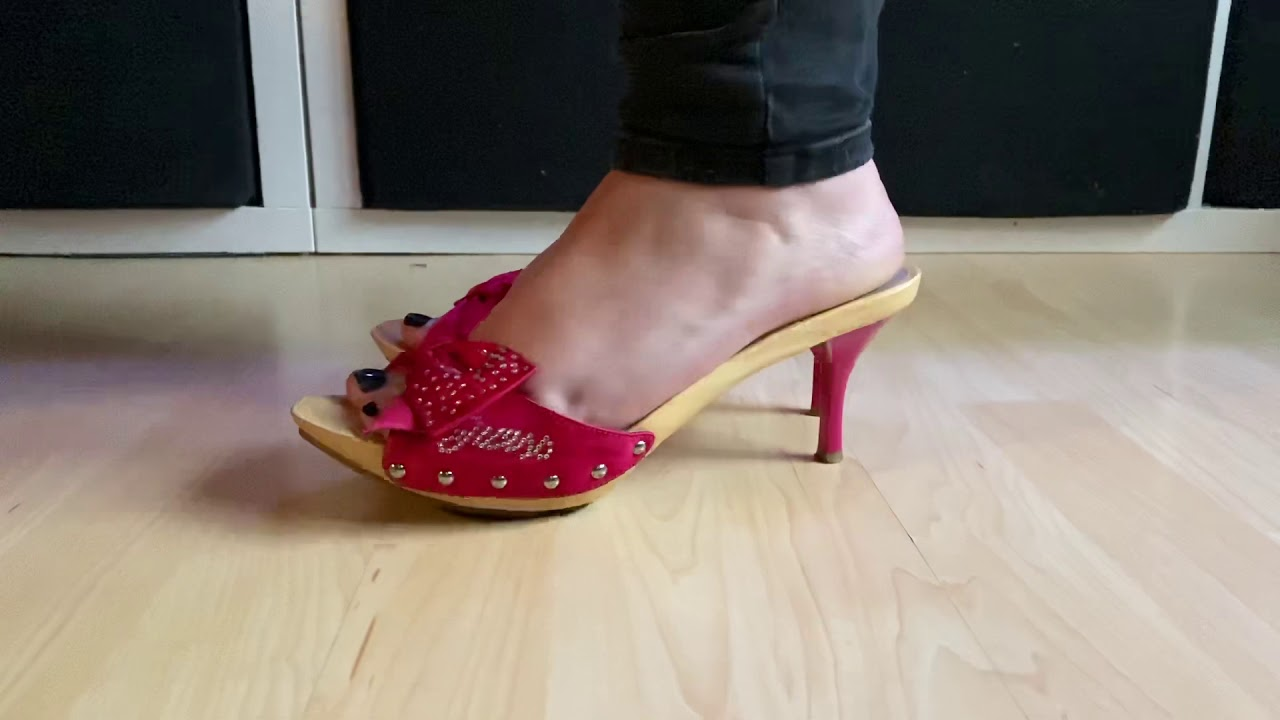 Mature feet on pink G high Heel mule