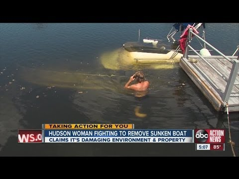 Hudson woman fighting to remove sunken boat