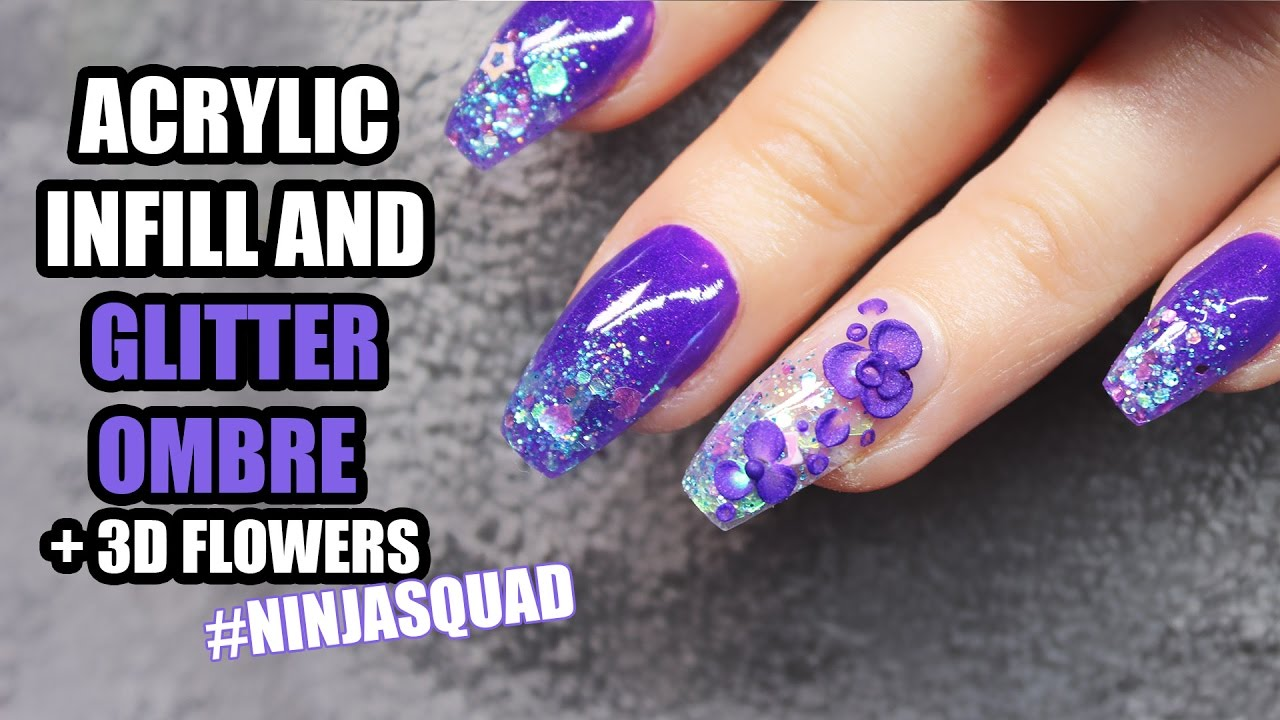 Coffin Shaped Acrylic Nails With Glitter Ombre And Purple Flowers