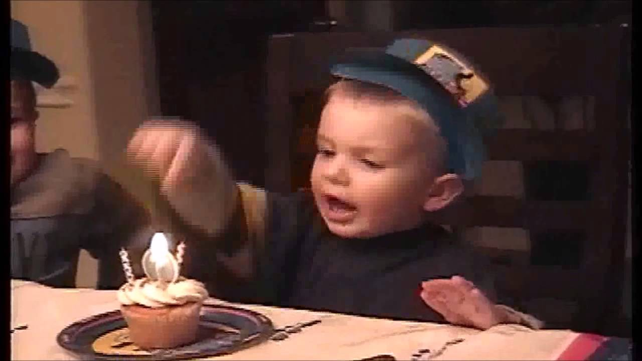 Blowing Out Candles On A Birthday Cake