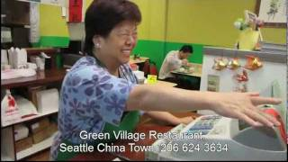 The happy singing boss of Green Village Restaurant
