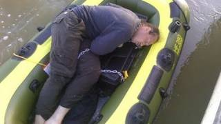 Unconscious Man Found in Boat, Chained to a Box.