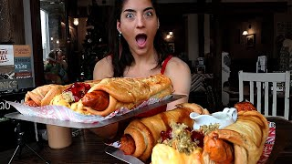 Girl eats 8LB of GIANT Pigs in blankets | Jingle Bell Hound | #LeahShutkever