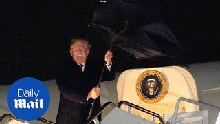 Trump's umbrella goes into a fit due to the windy weather - Daily Mail