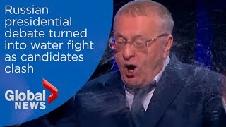 Russian presidential candidate throws water at opponent, sending debate off the rails