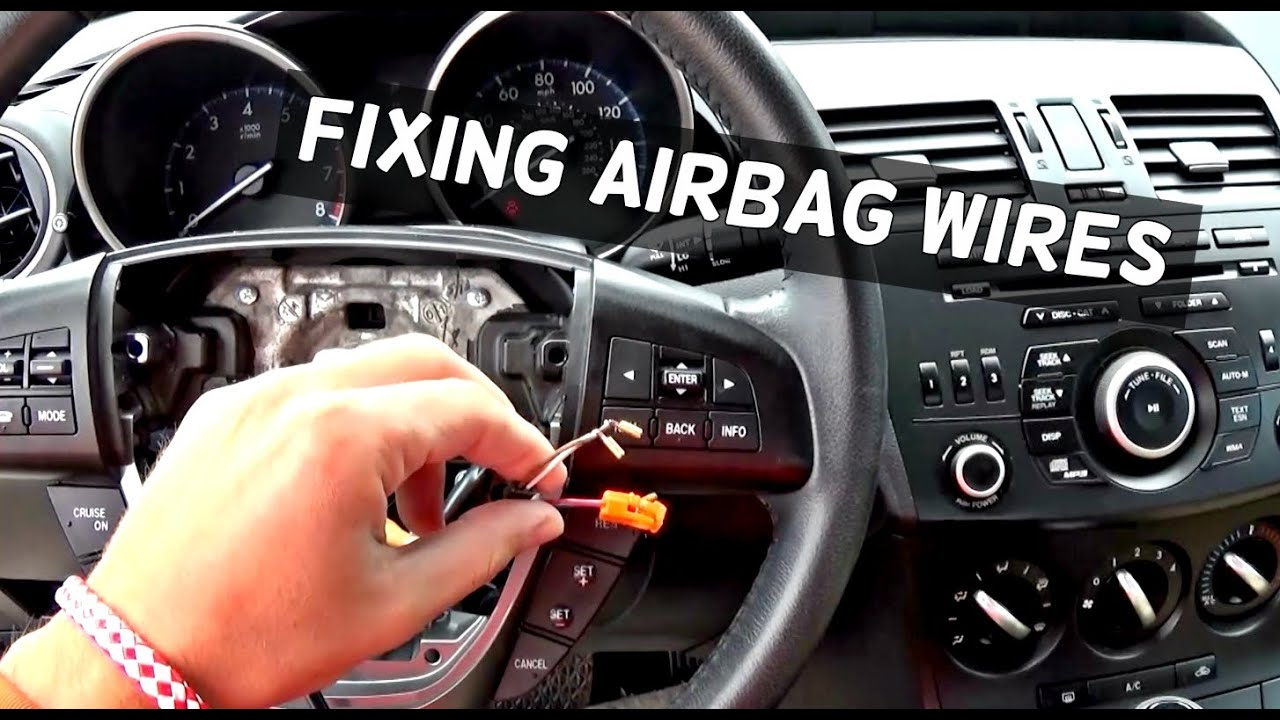 how to fix exploded steering wheel airbag wires demonstrated on mazda 3 [ 1280 x 720 Pixel ]