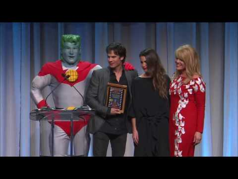 Ian Somerhalder accepting the Superhero for Earth Award with Nikki Reed