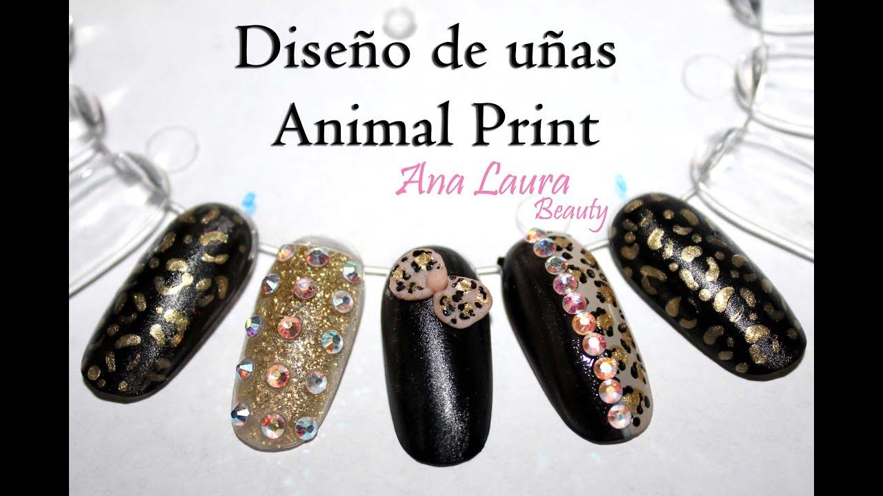 Diseño de uñas animal print dorado y negro