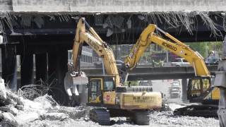 Watch: Crews demolish damaged sections of I-85 bridge structures