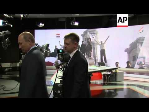 Putin visits Russia Today, news channel funded by Kremlin