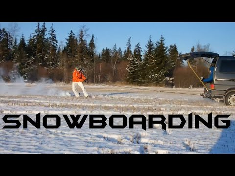 Snowboarding behind a car in LITHUANIA