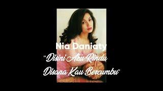 Download Nia Daniaty - Disini Aku Rindu Disana Kau Bercumbu