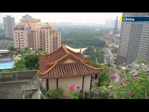 China's rogue rooftop real estate trend: apartment block residents report illegal rooftop temple