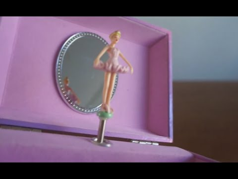 Play with the pink and purple MUSIC BOX with ballerina dancing on SWAN LAKE music
