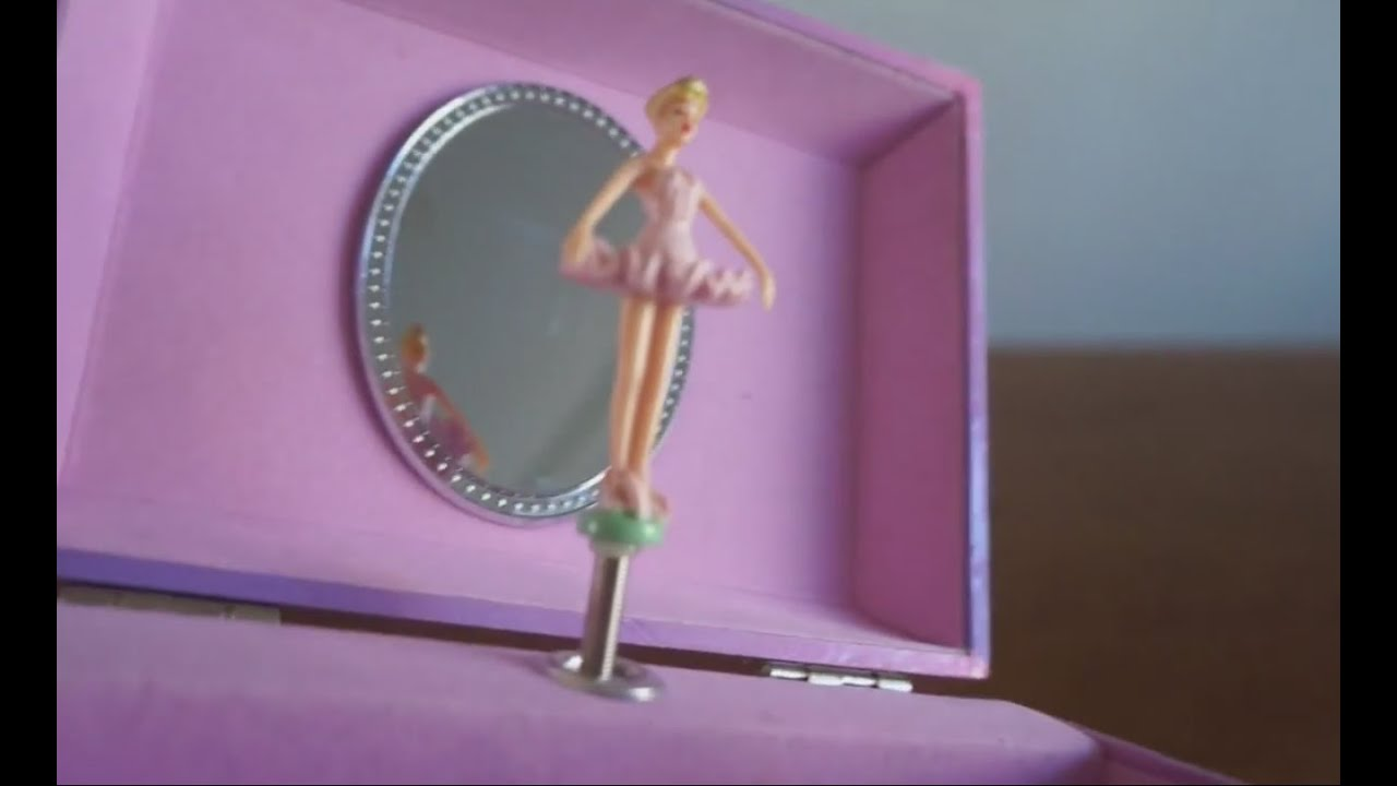 play with the pink and purple music box with ballerina dancing on