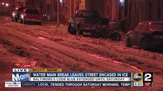 Street frozen, cars trapped in ice after water main break in Fells Point
