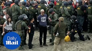 Police arrest religious protesters supporting caravan migrants