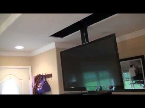 Drop down motorized tv lift setup demo led tv streight for Motorized flip down tv mount