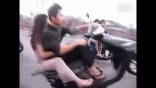 This guy put up his motorcycle's head when he was driving and his girlfriend looks so calm.
