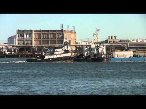 Tugboats Move Oil Barge
