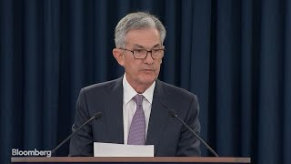 powell-fed-rate-cut-insurance-ongoing-risks