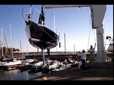 Hauling out a J/105 sailboat on a crane