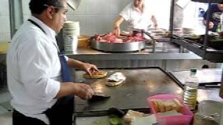 """Mexican Taco Vendor Is Preparing A """"torta"""" Sandwich"""