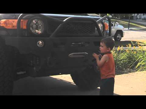 Holden cleaning the FJ