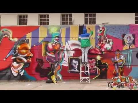 Graffiti Artists At Work In Bogota Colombia