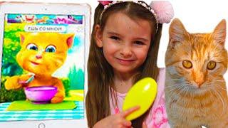 Девочки Ксюша и Арина кушают и играют с смешным котом из игры