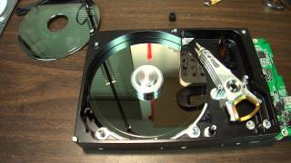 How to: a Clicking hard drive that was damaged disassembled it's unhappy