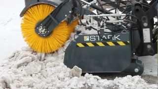 JCB 412s + STARK Bucket sweeper removing packed snow