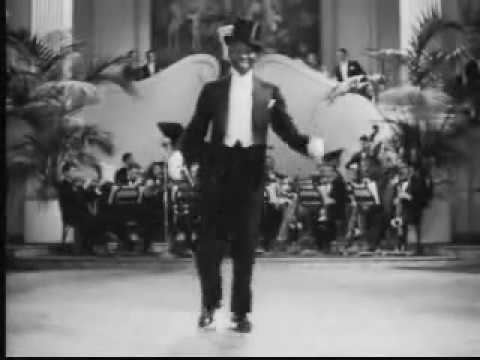 Bill Robinson in deleted opening number from Cafe Metropole (1937)