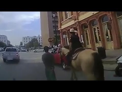 Bodycam video released of mounted Texas police leading black man through streets on a rope