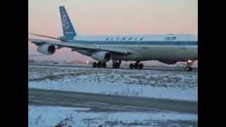Olympic Airlines Airbus 340-300 taxiing to runway 06R in Toronto Pearson airport