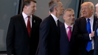 Raw: Trump Pushes Past Montenegro PM at NATO thumbnail