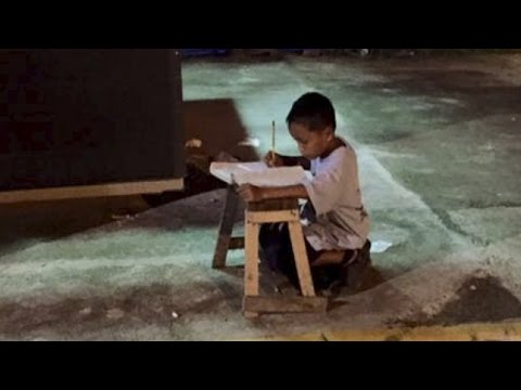 Homeless Boy Does Homework By Light Of McDonalds...His Story