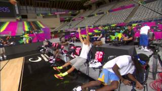 Stephen curry and kenneth faried have a light-hearted shooting contest while sitting on the bench during team usa practice break in spain.about nba: th...