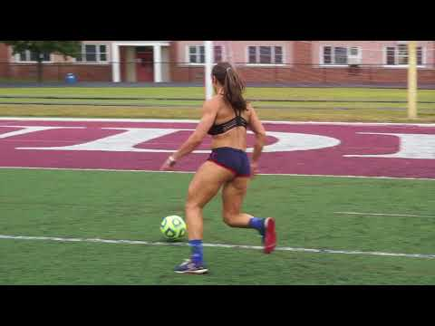 Crossfit girl tries to kick a soccer ball