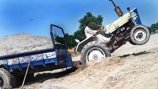 best tractor fails  ,ford tractor stuck in sand pulling video