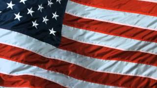 American Flag Slow Motion US Waving Flying Flag taken on High Speed Video Camera in Slowmo HD