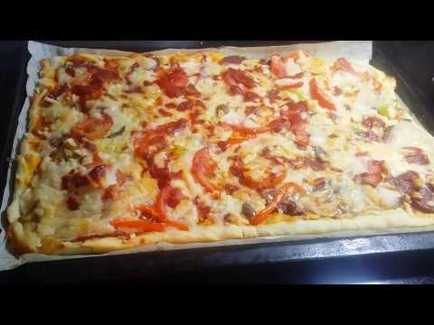 صورة  طريقة عمل البيتزا طريقة عمل البيتزا بأنواع مختلفة طريقة عمل البيتزا من يوتيوب