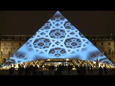 Images adorn Paris Louvre Pryamid as Abu Dhabi museum opens