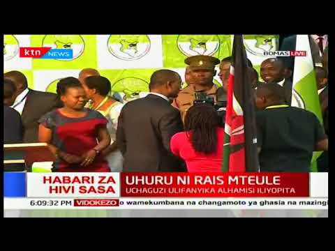 President Uhuru Kenyatta and DP William Ruto receive their certificates from IEBC Chairman