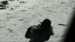 Crazy Woman caresses dead seagull