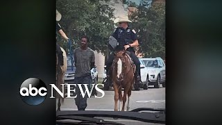 Photo of mounted officers leading black man by rope sparks outrage