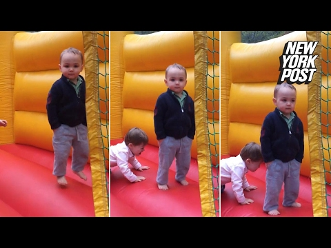 Thumbnail: The world's most serious toddler keeps things professional in a bouncy castle | New York Post